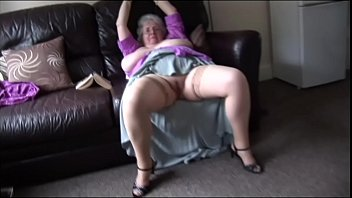 Granny shows off her huge tits and hairy pussy