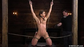 Bound brunette hottie Paige Owens on her knees gets clamped and whipped then with dildo on a stick gagged and pussy fucked and asshole vibrated by master The Pope on hogtie