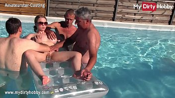 MyDirtyHobby - German amateur babe with big tits and pussy piercings gets fucked underwater by 3 horny old guys
