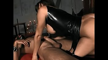 Busty mistress Judit Fox allows her slave to touch her twat after punishing him on the cross
