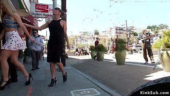 Brunette mistress spanks blonde Candice Dare and makes suck dick before gets butt plug in public