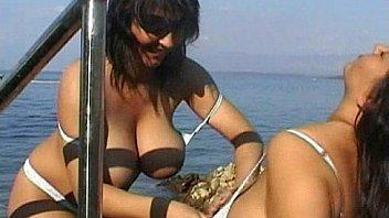 Busty Lesbian under water