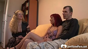 Blonde chick will watch this dude bang a beautiful redhead babe on the sofa.