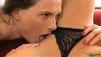 Lesbian friends licking each other
