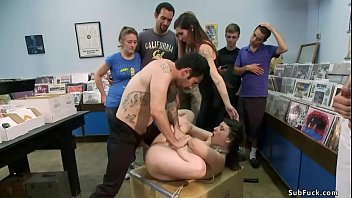 Busty blindfolded and rope bound brunette slave Terra Incognita is fingered by mistress Princess Donna Dolore and anal fucked by Tommy Pistol at public records shop