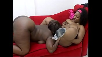 Couple of ebony BBW MILFs have a fun licking and toying their cunts