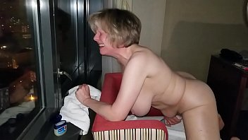 Mom makes herself cum in the window