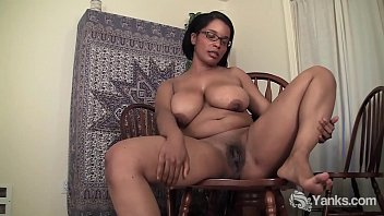 Voluptuous ebony babe with glasses from Yanks Natalia Johnson riding a chair to orgasm
