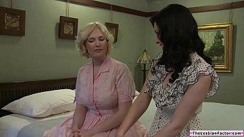 Brunette lesbian sucking the new tenants huge tits