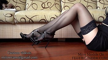Girl Shows Her Legs In Nylon Stockings And High Heels