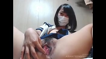 Slutty college girl from Japan exposes her twat on webcam