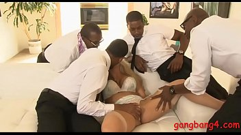 Massive boobies blonde bitch Holly Heart double penetrated in her pussy and asshole by black men on the couch