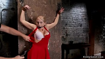 Gagged and tied up blonde pussy banged with black dick on a stick in dungeon