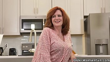 American milf Rebecca gets her pussy boiling hot and perfectly well done with her dildo in the kitchen. Bonus video: USA milf Andi James.