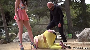 Master and mistress spanking yellow haired slave and plugging her butt