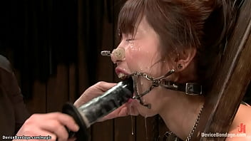 Gagged Japanese slut Marica Hase throat fucked through spider gag with dildo then ass whipped and finger fucked by lezdom Claire Adams on device bondage