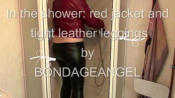 MILF in leather clothes is taking a shower