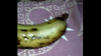 Tamil girl play with banana