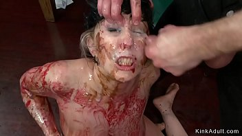 At public soup course busty tied brunette babe Nerine Mechanique is double penetration fucked with dildos on a sticks then dirt in food gets facial