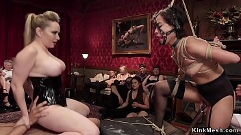 Sexy petite brunette ebony slave gets fisted by master and mistress then in bondage vibrated while watching dom fuck in bdsm party in the upper floor