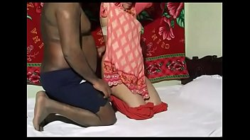Indian couple fucking under a red carpet decoration