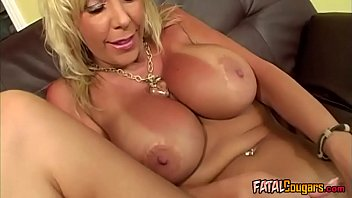 These boobs are really huge! Blonde milf with huge knockers becomes rammed and banged from behind in doggystyle!