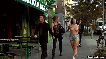 Mona Wales disgraces bare big tits brunette slave Pina De Luxe outdoor in public street then in fetish bar makes her fuck