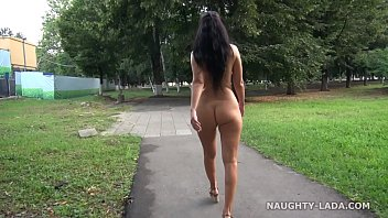 Naughty Lada walks naked in the city and enjoys public nudity
