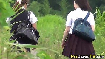 Urinating teen asians