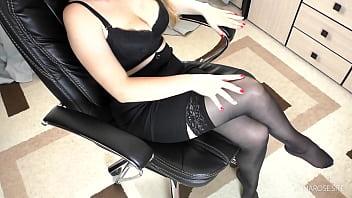 Secretary in stockings femdom handjob on her Legs