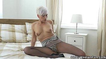 Euro milf Kathy White fingers her pussy in nylon Thumbnail
