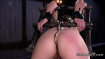 Gagged and bent over in metal device bondage brunette slave anal hooked