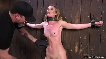 Master locked blonde slave to the wall then in metal device bondage torments her bare feet