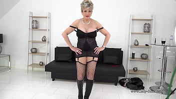 Big titty biker MILF shows off her sexy lingerie and huge tits