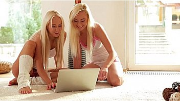 Fun loving blondes Naomi Nevana and Carla Cox get aroused as they watch some lesbian porn together