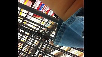 At store in blue jean shorts skirt