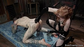 Watch Blonde shemale with big dick in lingerie put alt man slave in doggy bondage and torment his cock preview